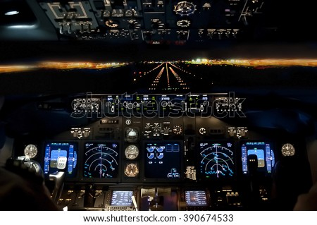 Final approach at night - landing of a jet airliner, view from the cockpit - stock photo