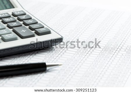 Finance analysis concept using finance sheet with pen and calculator - stock photo