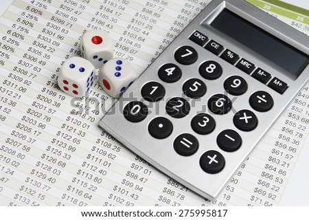 Finance analysis with dice and calculator - stock photo