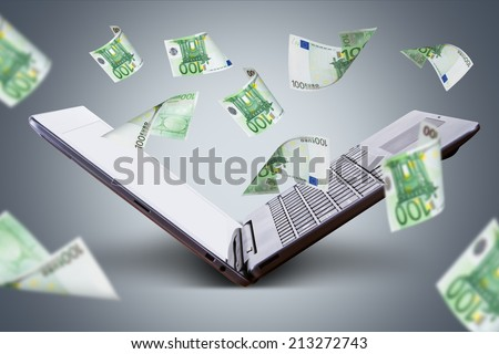 Finance and earning concept, one hundred euro banknotes flying around laptop, internet, side view on dark background. - stock photo