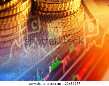 Finance background with graph and coins. - stock photo