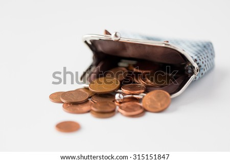 finance, cash, money saving and investment concept - close up of euro coins and wallet on table - stock photo