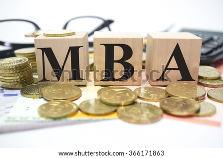 Finance Concept with Stack of Coins, MBA or Master of Business Administration written - stock photo