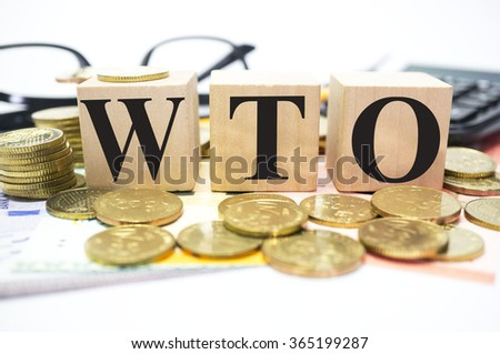 Finance Concept with Stack of Coins, WTO or World Trade Organization written - stock photo