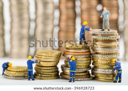 Finance team ,stack of money businessman model standing for showing growing statements progress. - stock photo