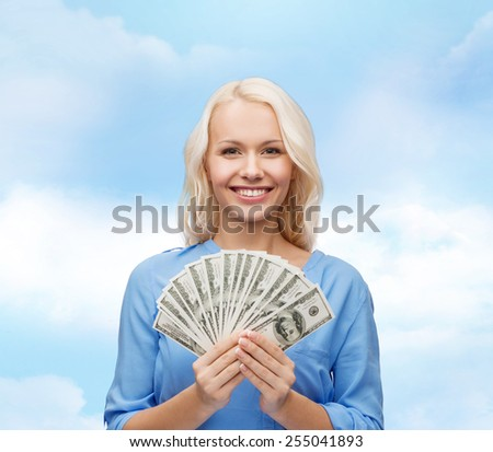 finances and people concept - smiling woman in red dress with us dollar money - stock photo