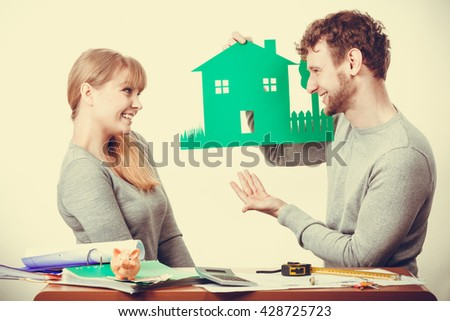 Finances property ownership real estate documents paperwork concept. Smiling couple preparing their future. Young girl and boy planning house for family. - stock photo