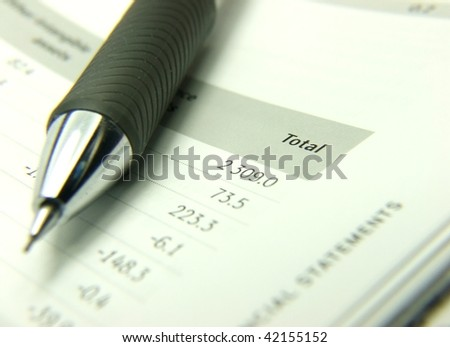 Finances statement with pencil - stock photo