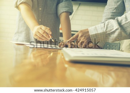 Financial,accounting,investment advisor consulting with young man at classroom. Business adviser and young student planing the business start up,man meeting banker,Selective focus,Vintage tone - stock photo