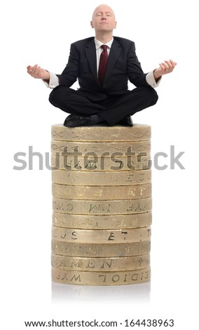 Financial Adviser sat on a stack of money - stock photo