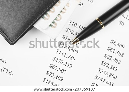 financial analysis chart with black wallet, pen and banknote - stock photo