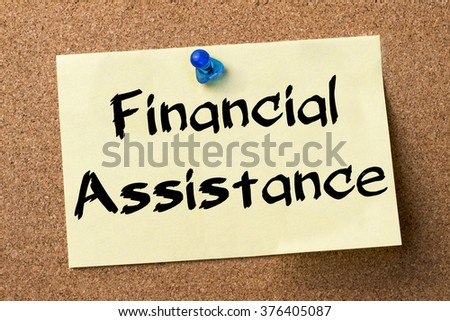 Financial Assistance - adhesive label pinned on bulletin board - horizontal image - stock photo
