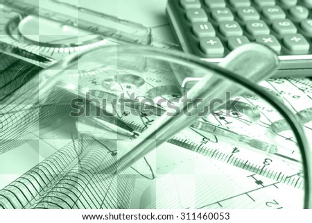 Financial background in greens with buildings, ruler, calculator and graph. - stock photo