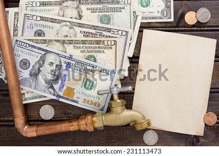 Financial charges for water. Water faucet on a background of dollars. - stock photo