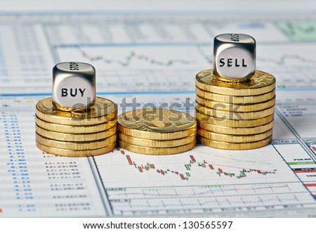 Financial chart, coins and dice cubes with the words Sell Buy. Selective focus - stock photo