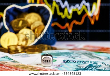 Financial chart, golden coins and dices cube. Selective focus - stock photo
