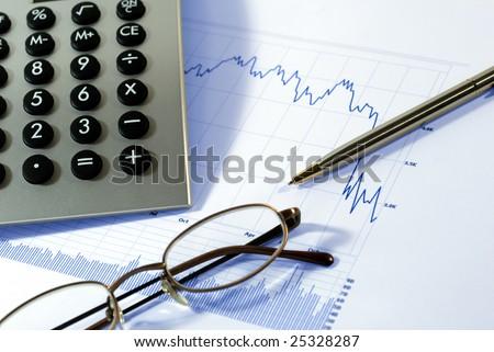 Financial chart, market's falling, calculator, pen, glasses - stock photo