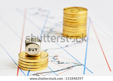Financial chart, rising coins stacks, dices cube with the word BUY. Selective focus - stock photo