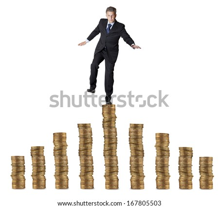 Financial concept. businessman standing on the coins  - stock photo