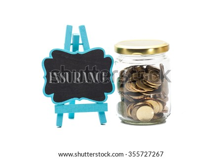 Financial concept. Coins in glass money jar with insurance word on chalk board - stock photo