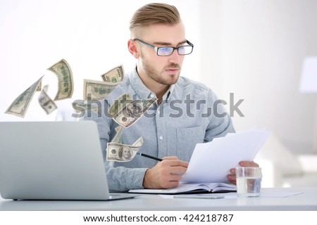 Financial concept. Make money on the Internet. Businessman working with laptop in office - stock photo