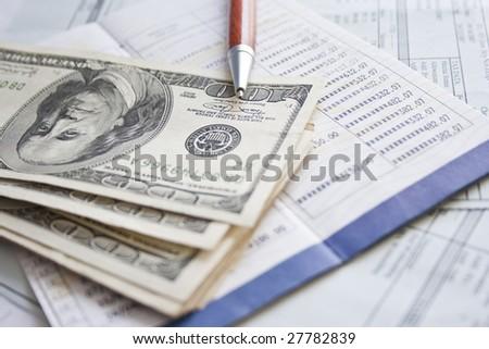 Financial concept - money, pen and financial documentation - stock photo