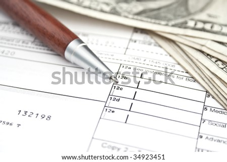 Financial concept - pen and money over financial documentation - stock photo