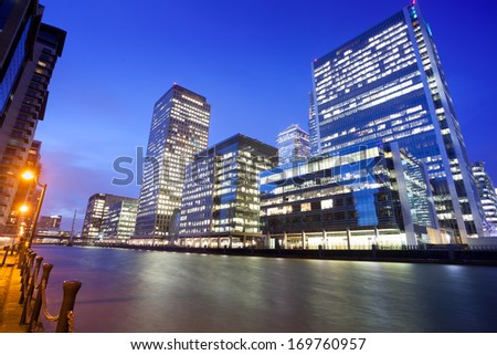 Financial Corporate building Skyscrapers office center in the Canary Wharf at night, City of London  - stock photo