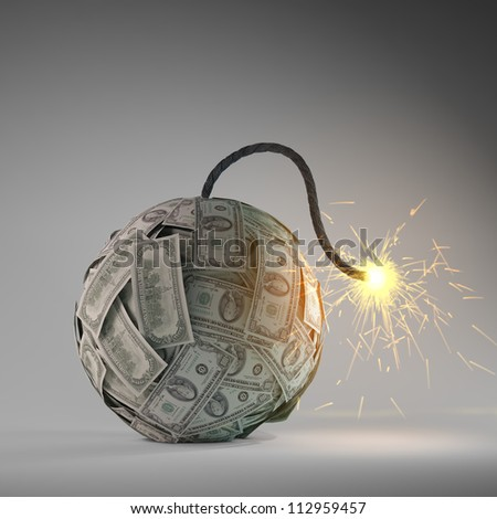 Financial crisis - an old bomb with a fuse made out of dollar bills - stock photo