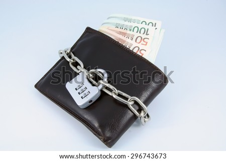 Financial crisis. Old brown leather wallet with lock on it. - stock photo