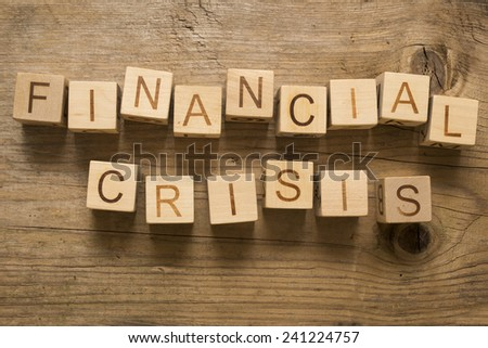Financial crisis text on a wooden blocks - stock photo