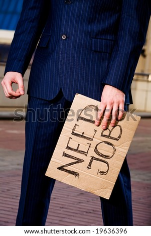 Financial crisis. Unemployment. Businessman holding sign Need Job outdoors - stock photo