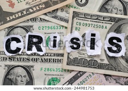 Financial crisis. Word Crisis on dollar banknotes. - stock photo