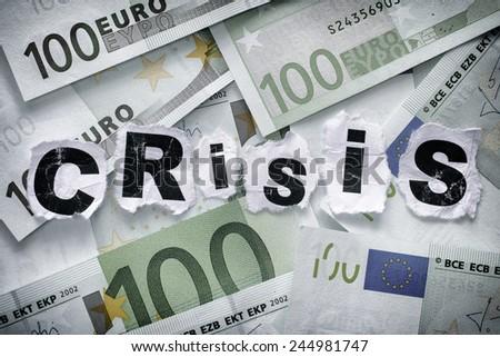Financial crisis. Word Crisis on euro banknotes. - stock photo