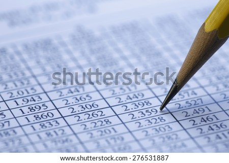 Financial data analyzing , shot with very shallow depth of field, blue toned. - stock photo