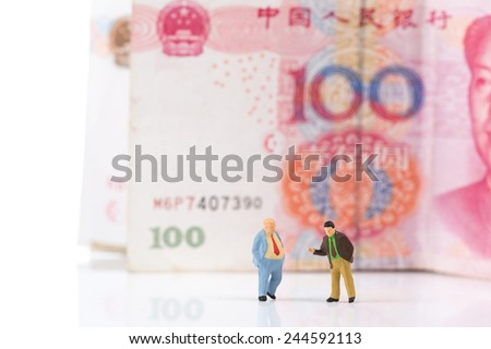Financial deal concept,businessmen with Chinese money banknotes background on white  - stock photo