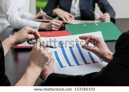 Financial diagrams on the top of business conversation - stock photo