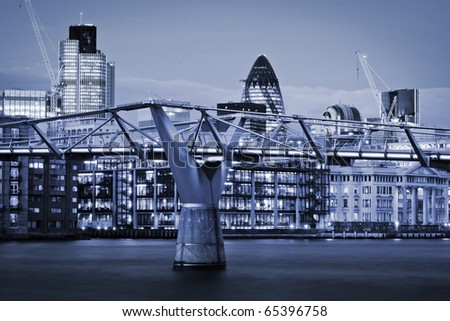 Financial District and Millennium Bridge, London. This view includes :Tower 42 Gherkin,Willis Building, and Stock Exchange Tower - stock photo