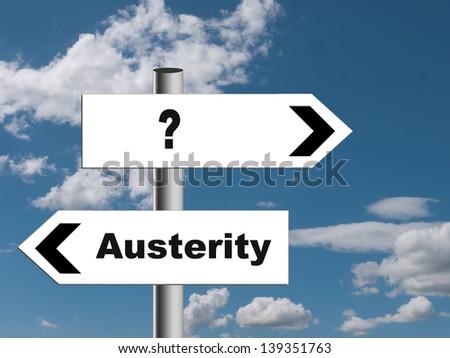 Financial economic crisis - austerity choice signpost - stock photo