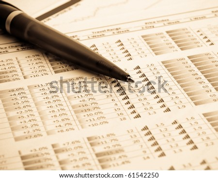 financial figures and pen - stock photo