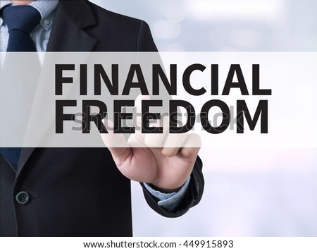 FINANCIAL FREEDOM Businessman touching a touch screen on blurred city background - stock photo