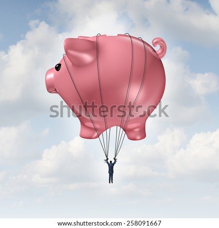 Financial freedom concept as a piggy bank hot air balloon lifting a businessman up to success as a wealth management and investment advice metaphor. - stock photo
