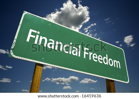 Financial Freedom Road Sign with dramatic clouds and sky. - stock photo