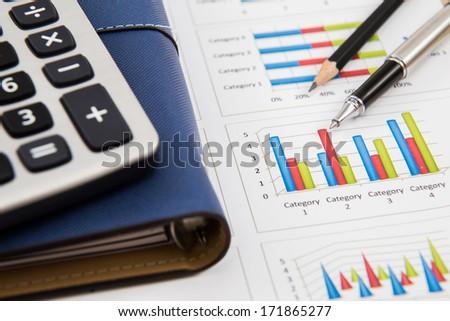 Financial graphs and charts accounting - stock photo