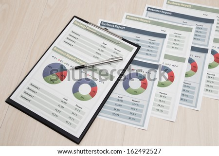 Financial graphs and charts on table - stock photo