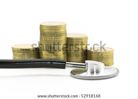 Financial health. Stethoscope with coins - stock photo