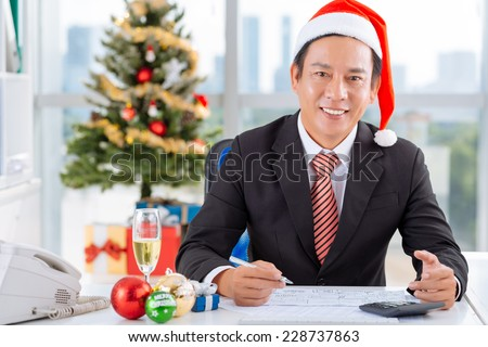 Financial manager working in the office on Christmas day - stock photo