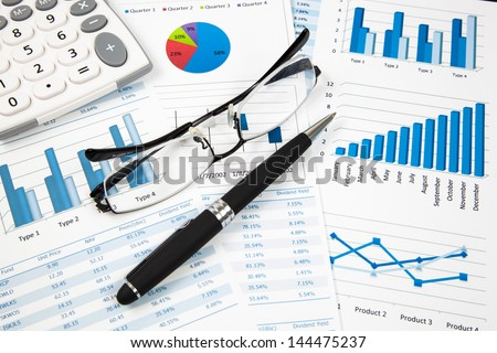 Financial paper charts and graphs - stock photo