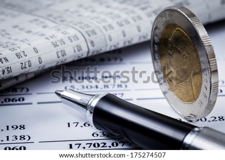 financial report with coins and calculator - stock photo