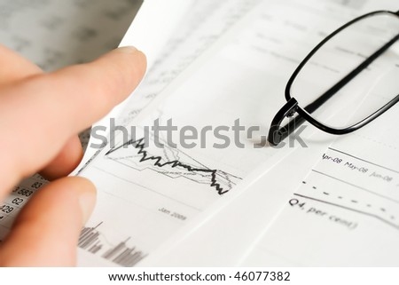 Financial reports analyzing. - stock photo